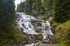 Waterfall. Beautiful vodovad on a mountain river in Alpah royalty free stock image