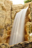 Waterfall. Beautifull waterfall. Foto with long time-exposure, against the rock Royalty Free Stock Photo