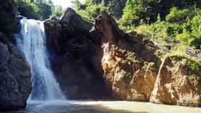 Waterfall beauty. Waterfall Baguite, Jarabacoa, a scenery of swimming area with small beach Stock Image