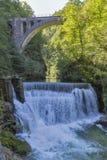 Waterfall beneath stone train bridge in the Vintgar gorge, Slovenia. Stock Images
