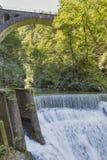 Waterfall beneath stone train bridge in the Vintgar gorge, Slovenia. Royalty Free Stock Images