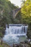Waterfall beneath stone train bridge in the Vintgar gorge, Slovenia. Royalty Free Stock Photography