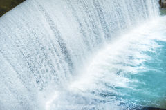 Waterfall on a big dam Stock Image