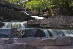 Waterfall on the big rocks Stock Images