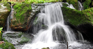 Waterfall on Bila Opava river in Jeseniky mountains. With stones covered by bryophyte Stock Photo