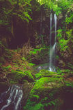 Waterfall and black cave , Auvergne, France Stock Photos