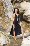 Waterfall and black dress Royalty Free Stock Image