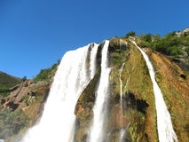 Waterfall with blue sky in the spring Stock Photography