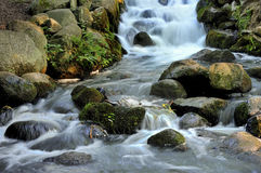 Waterfall and blue stream - a fragment Royalty Free Stock Photography