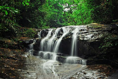 Waterfall with blue stream Stock Photos