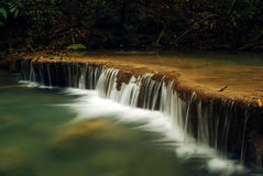Waterfall with blue stream Royalty Free Stock Photo