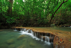 Waterfall with blue stream Royalty Free Stock Image