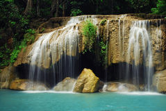 Waterfall with blue stream Stock Image