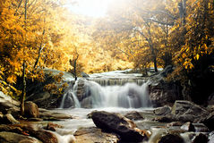 Waterfall and blue stream Stock Photo