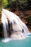 Waterfall of blue waters. A waterfall running blue waters Stock Images