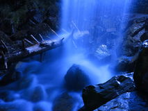 Waterfall blur dark-blue by night. Long exposure of a waterfall illuminated by night royalty free stock photo