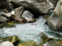 Waterfall and boulders Stock Images