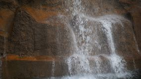 Waterfall and Brick Wall. Dreamy Waterfall and Brick Wall in a Park stock footage
