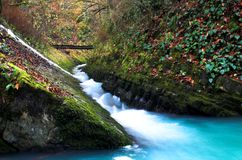 Waterfall with the bridge. And the rock Royalty Free Stock Photo