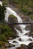 Waterfall and a bridge. Near Briksdal Norway Royalty Free Stock Photos
