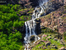 Waterfall in Briksdal Glacier mountain range, Norway. Stock Photos