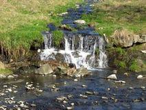 Waterfall on the brook Stock Photo
