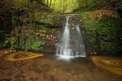 Waterfall Butzerbachtal during fall in the Eifel Stock Images