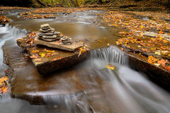 Waterfall Cairn. A small waterfall with a Cairn on Brandywine Creek in Cuyahoga Valley National Park Ohio. Seen here in autumn with colorful fallen leaves royalty free stock photos