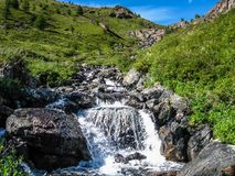 Glacier waterfall. Gorge Kuektanar. Mountain Altai stock image