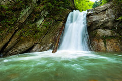 Waterfall in a canyon Stock Image