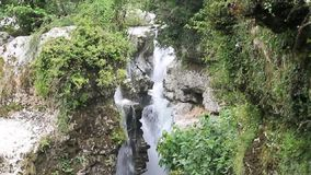 Waterfall in the canyon stock video footage
