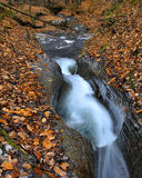 Waterfall Cascade. Water flowing through a smooth rock crevice in the fall Stock Images