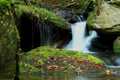 Waterfall - cascade in the autumn forest Royalty Free Stock Photography