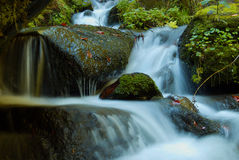Waterfall - cascade in the autumn forest Stock Photography