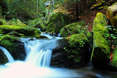 Waterfall - cascade in the autumn forest Stock Photos