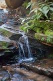 Waterfall cascade in the garden Royalty Free Stock Photo