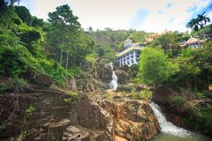Waterfalls in Tropics by Monastery Buildings in Vietnam Royalty Free Stock Photography