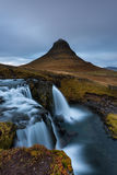 A waterfall cascade near Kirkjufell mountain in Iceland. Royalty Free Stock Photos