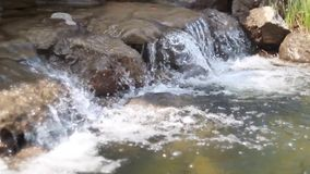 Waterfall cascades flowing over flat rocks stock video footage