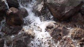 Waterfall cascades flowing over flat rocks stock video
