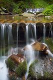 Waterfall with cascades on a mountain river Stock Photo