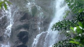 Waterfall cascading down in national park stock video footage