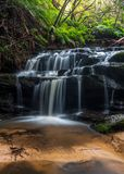 Water cascades over rocks in Leura royalty free stock images