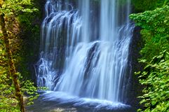 Waterfall cascading in Lower South Falls in Silver Falls State Park. Waterfall with soft flowing cascading water in Silver Falls park, Oregon royalty free stock images