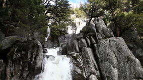 Waterfall Cascading Over Granite Rock Yosemite Park California. Water Cascading Down Over Granite Rock With Trees Yosemite Park stock video