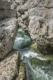 Waterfall cascading over rocks in blue pond Royalty Free Stock Photo