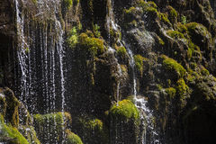 Waterfall cascading over rocks . Stock Photography