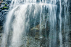 Waterfall Cascading over Rocks Stock Photo