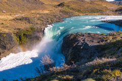 Waterfall cascading with a thunderous roar in the Torres del Paine stock photos