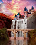 Waterfall Castle. Castle over a waterfall with a bridge in the foreground during sunset stock images